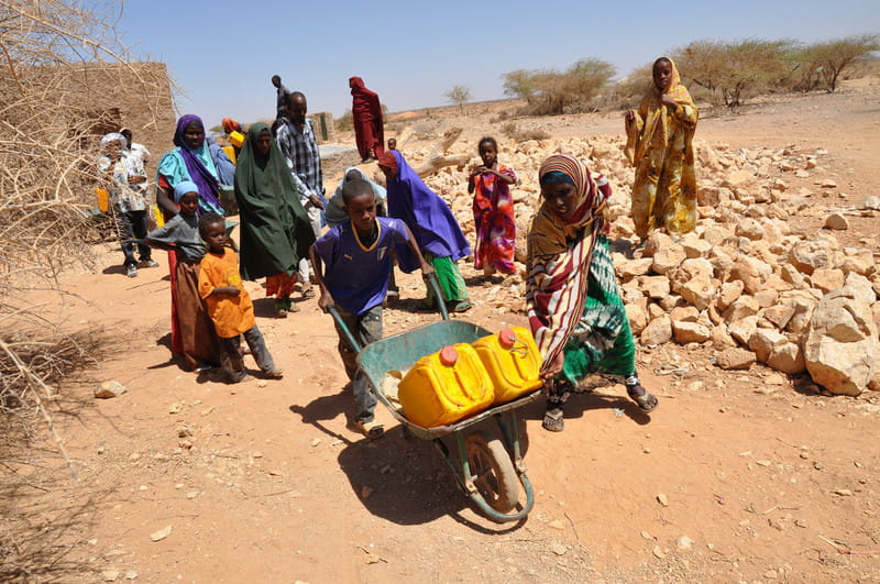A family in Somalia collects their daily water allowance