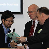 Receiving a book prize from Jack Melling and Ray Boucher
