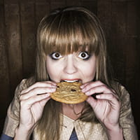 Girl eating biscuit