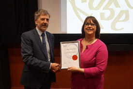 Dr Alan Baylis presents Helen Bonser-Wilton with her certificate