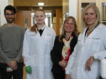 Elizabeth Winzeler, PhD (right), and her malaria research team at UC San Diego School of Medicine.