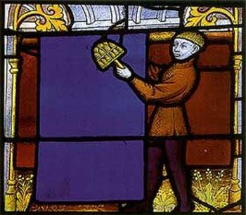 Cloth worker using a teasel frame to card cloth, 15th century stained-glass window, Notre Dame de Semur-en-Auxois, France.