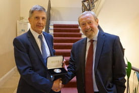 Sir John Beddington is presented with the Sydney Andrew Medal