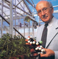 Michael Elliott holding a model of the insecticide deltamethrin