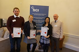 Previous winners, Thomas Britten, Isobel Mackay, and Kay Yeung with Alan Heaton.