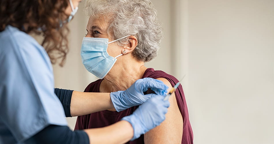SCIblog 19 January 2021 - image of and elderly woman receiving a vaccine